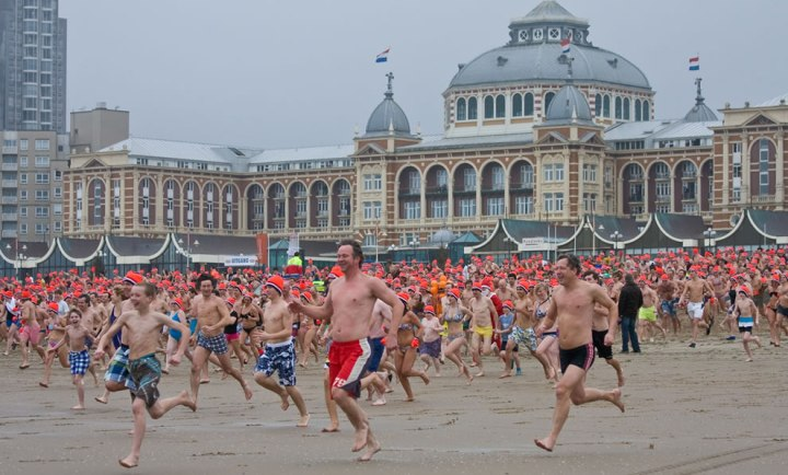 10000-people-run-toward-the-freezing-water-for-Nieuwjaarsduik-a-New-Years-Dive-Scheveningen-Netherlands