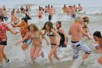 Mad-Dash-Out-of-the-water-after-polar-bear-plunge-on-New-Years-Day