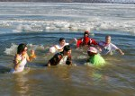 Polar-Bear-plunge-brave-folks-were-dressed-for-a-beach-in-Hawaii-but-instead-found-themselves-in-the-frigid-waters-of-the-Mississippi-for-a-good-cause