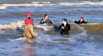 Polar-Bear-swim-at-The-Hague.-Traditionally-the-few-members-of-the-Hague-Sudenten-Association-dressed-in-suits-take-to-the-sea-and-toast-to-good-New-Years-wishes