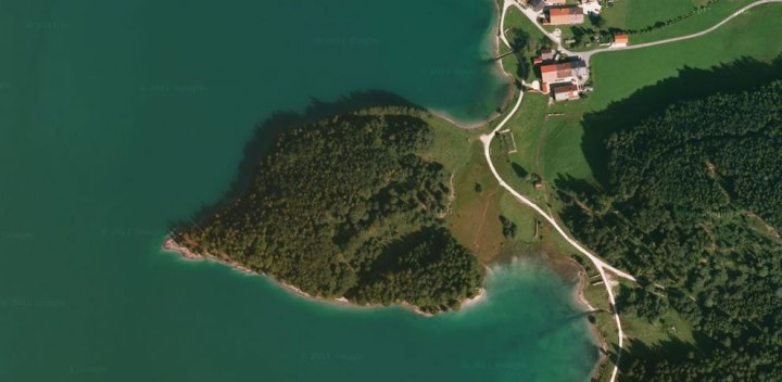 Aerial-view-of-heart-shaped-forested-island-in-Walchensee-Germany