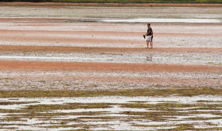 Visible-orange-sand-during-low-tide-along-Northumberland-Strait-Victoria-Prince-Edward-Island-CA